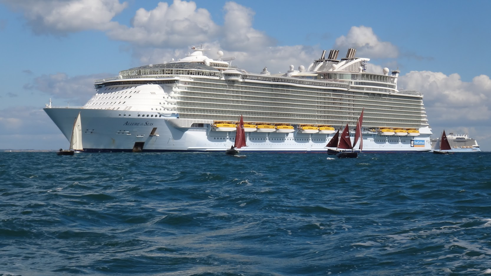19 Poole Shrimpers, including 7 PYC boats sail around one of the biggest passenger ships in the world